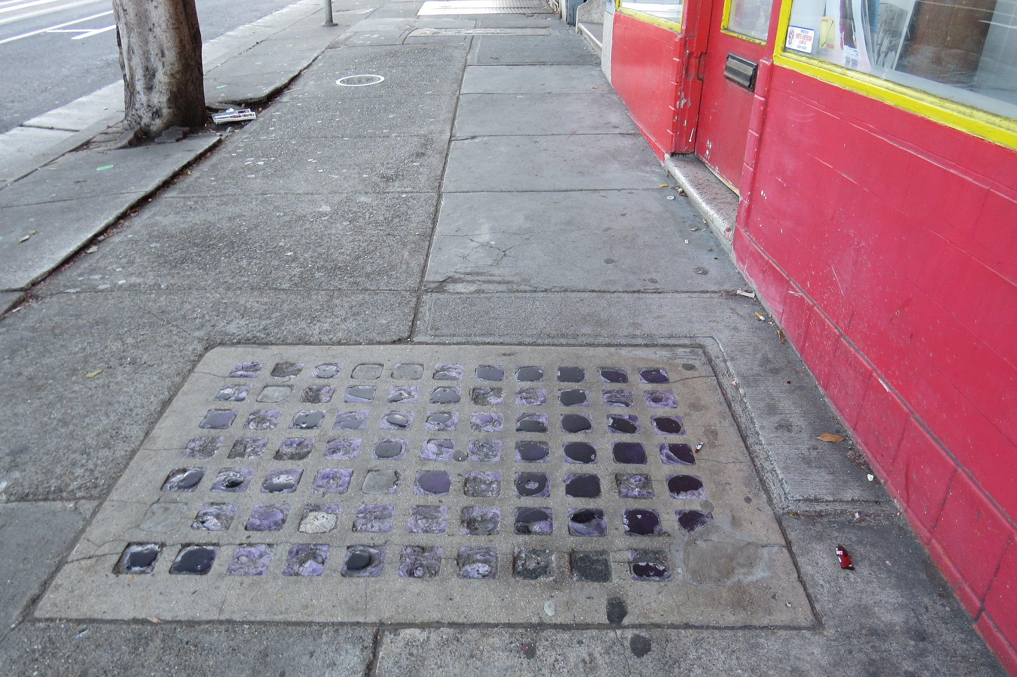 What Are Those Grids of Glass in the Sidewalk — And Why Are They Purple?