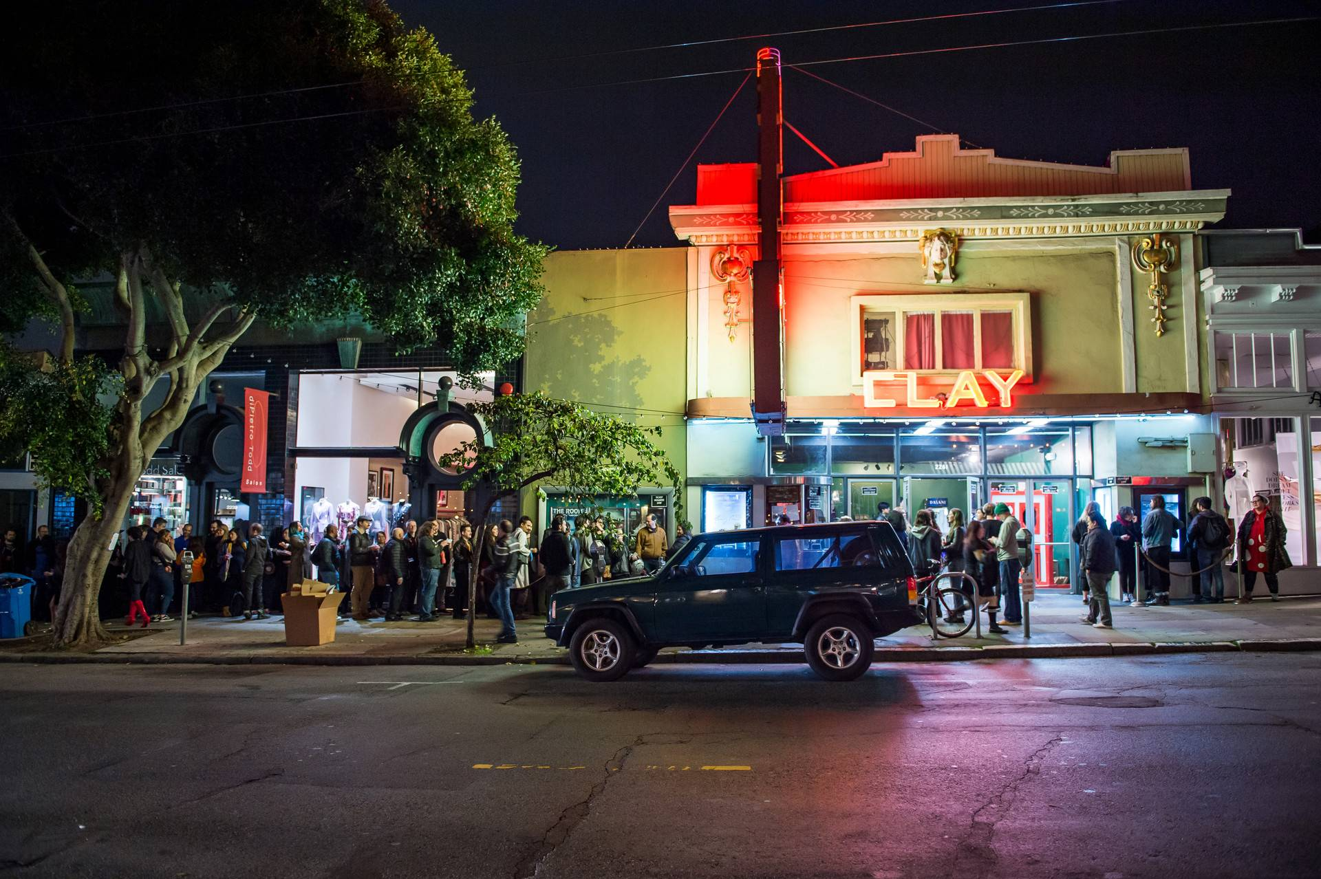Crowds line the sidewalk waiting to enter the Clay Theater for a sold-out performance of the Rocky Horror Picture show on Saturday. This midnight movie performance is the last for the theater, which is shutting its doors on Sunday after 110 years. Beth LaBerge/KQED