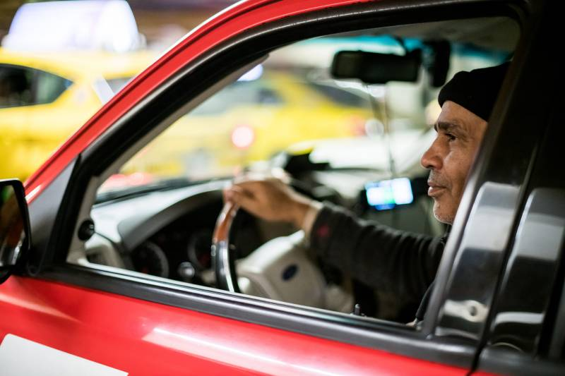 Ejaz Ahmed waits in the short term parking garage at San Francisco International Airport on Jan. 30, 2020. Taxi drivers can often wait up to an hour or more waiting to pick up a fare.
