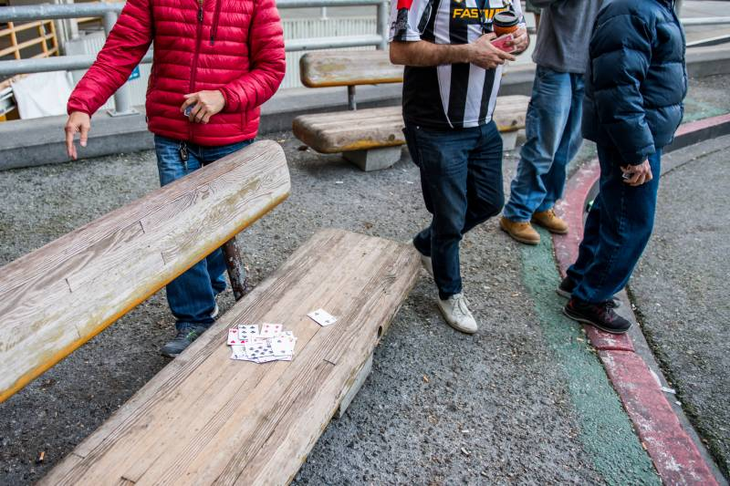 Taxi drivers play cards while they wait to pick up passengers at San Francisco International Airport on Jan. 30, 2020.