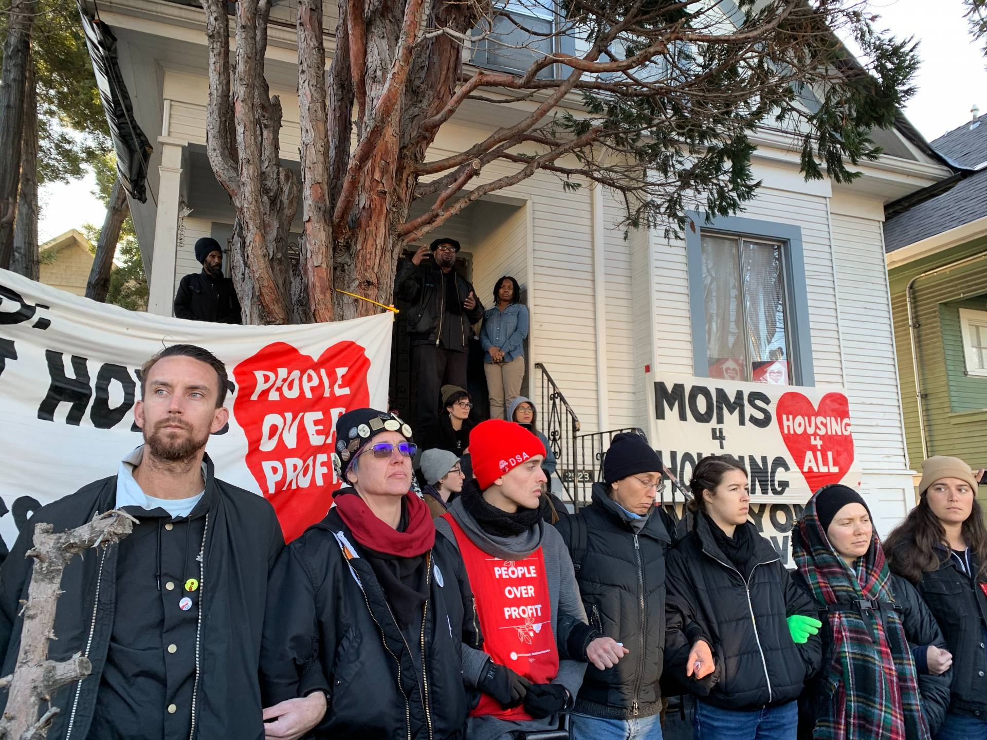 Supporters of Moms 4 Housing rally in front of the West Oakland house the group occupied for several months before being forcefully evicted in January. A community land trust has since agreed to purchase the house and allow the women move back in.