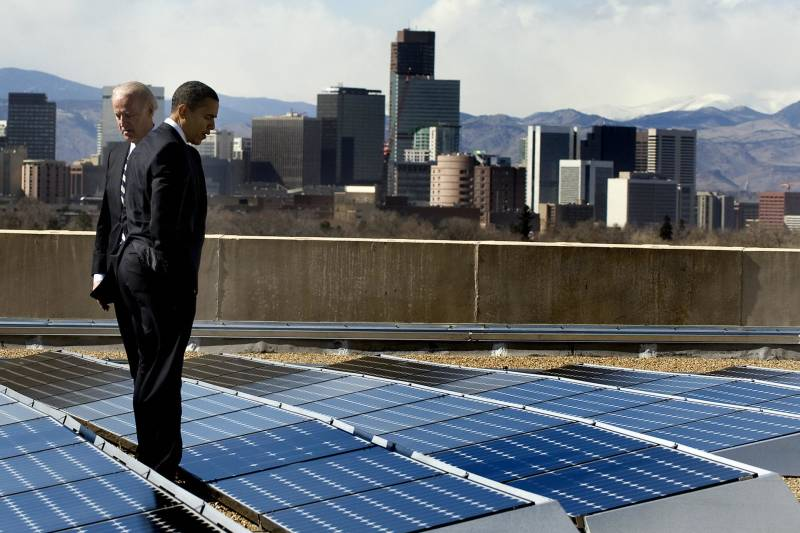U.S. President Barack Obama and Vice President Joe Biden look at solar panels as they tour the solar array at the Denver Museum of Nature and Science in Denver, Colorado, February 17, 2009.
