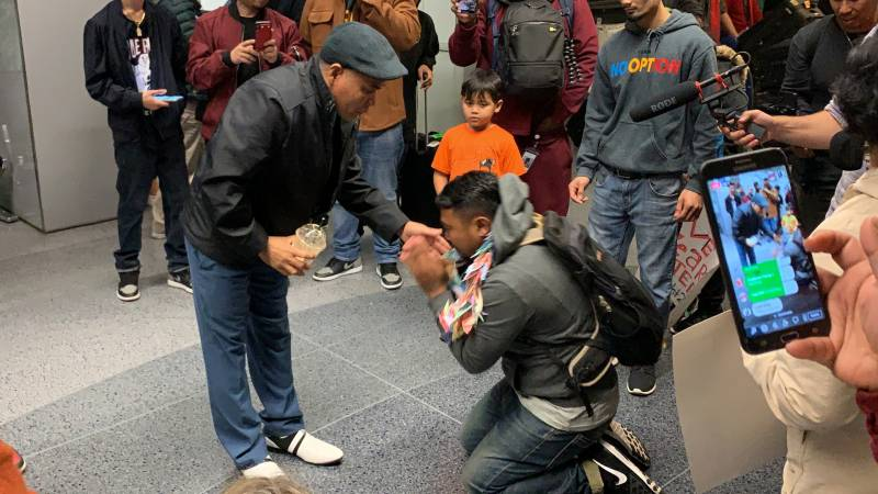 As a sign of respect and reverence in Cambodian culture, Sok Loeun kneeled at his father's feet after arriving back in the U.S. for the first time in five years.