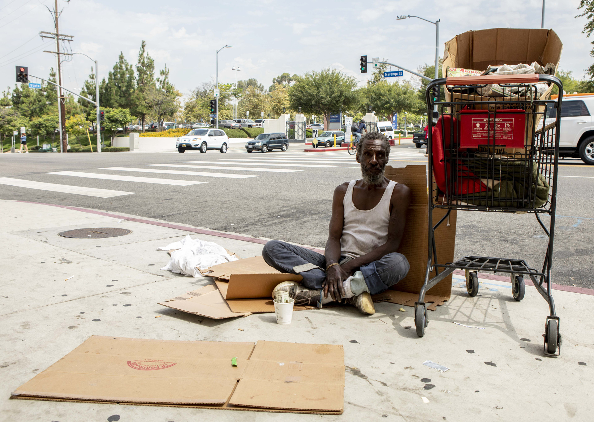 Will, who provided his first name only, sits on the sidewalk across the street from LAC+USC Medical Center to panhandle for money until he has enough to go to McDonalds down the block. Will has been homeless since he arrived in Los Angeles from Chicago in 1982.