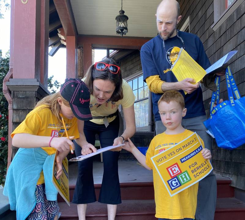 Dan and Jenny Mulholland-Beahrs with their kids, Callie and Joel, go door to door in support of Measure E on the March 3 ballot, which would raise local property taxes to fund raises for teachers in Berkeley Unified School District.