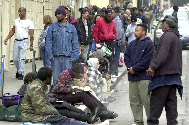 Dozens of homeless people line up for a meal at St. Anthony's Church on Dec. 6, 2002 in San Francisco.