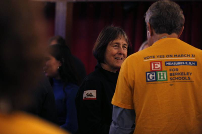California State Senator Nancy Skinner talks with members of the Berkeley Federation of Teachers at an election watch party at Spats in Berkeley on March 3, 2020.