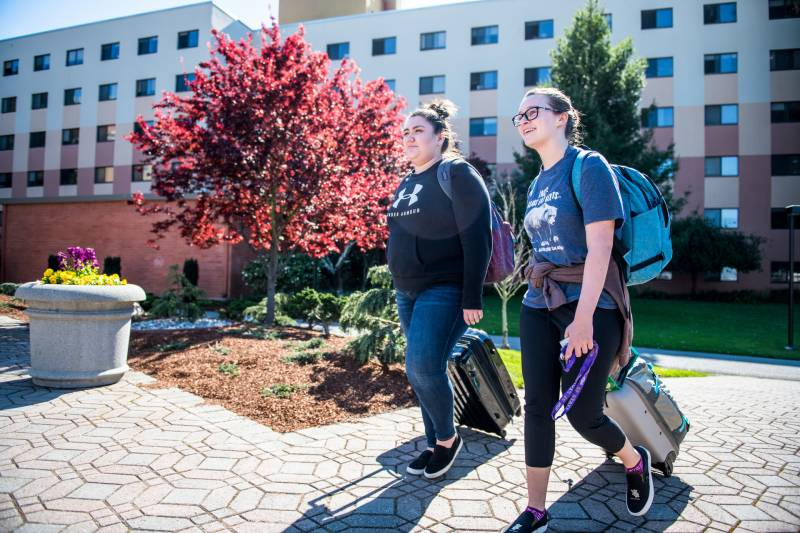 San Francisco State University freshman students Alexa Nunez (left) and Abbey Gassaway walk with their belongings to turn in their room keys on Wednesday, Mar. 11, 2020. The university advised students to move out of their dorms and return home to help curb the spread of coronavirus.