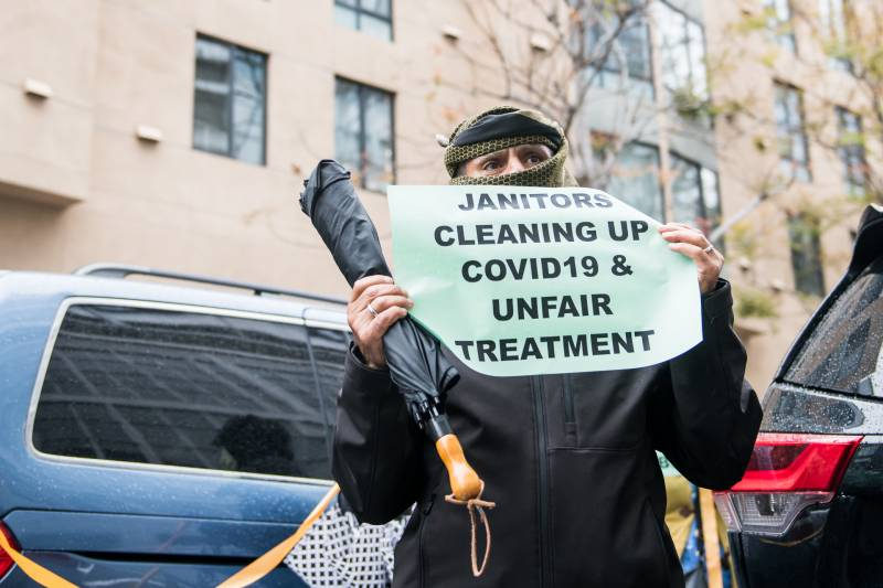 Madi Deonah, a janitor at 130 Kearny Street in San Francisco, protests alongside fellow janitors outside of Lyft headquarters on April 6, 2020.