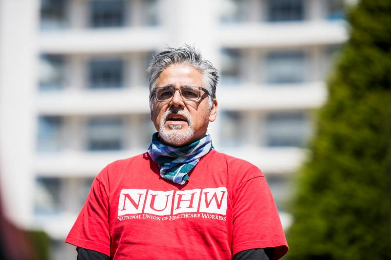 John Avalos, former San Francisco Supervisor and an organizer for the National Union of Healthcare Workers, speaks at a press conference at Seton Medical Center on April 2, 2020.