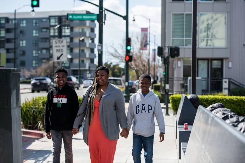 Carolyn Bims-Payne and her two sons go for a walk to take a break from work and schoolwork while sheltering in place.