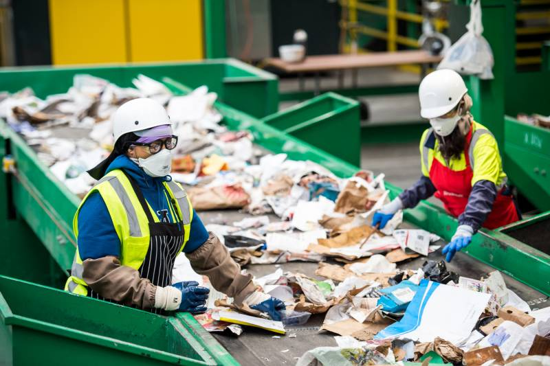 Recology employees separate garbage from recyclables at a processing facility at Pier 96 in San Francisco on April 9, 2020.