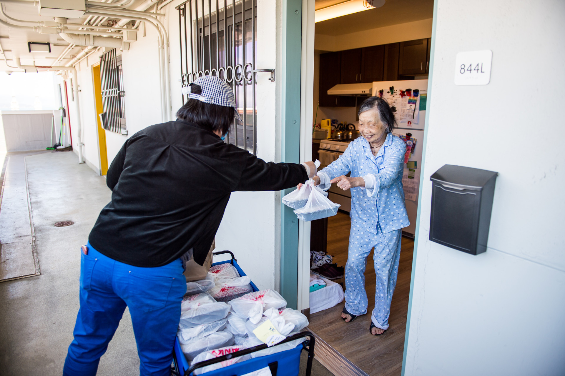 Ruqiong Fang delivers meals to residents at Ping Yuen, a public housing building in Chinatown, on April 5, 2020. Fang volunteers five days a week to help deliver meals.
