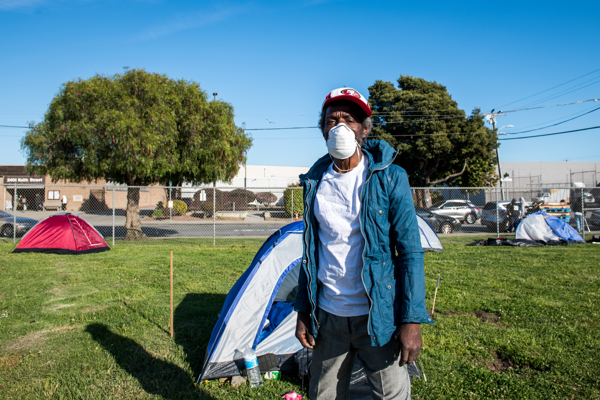 Eddie Tillman stands outside his tent at Bay View Park K.C. Jones Playground - also known as MLK Park - on May 5, 2020.