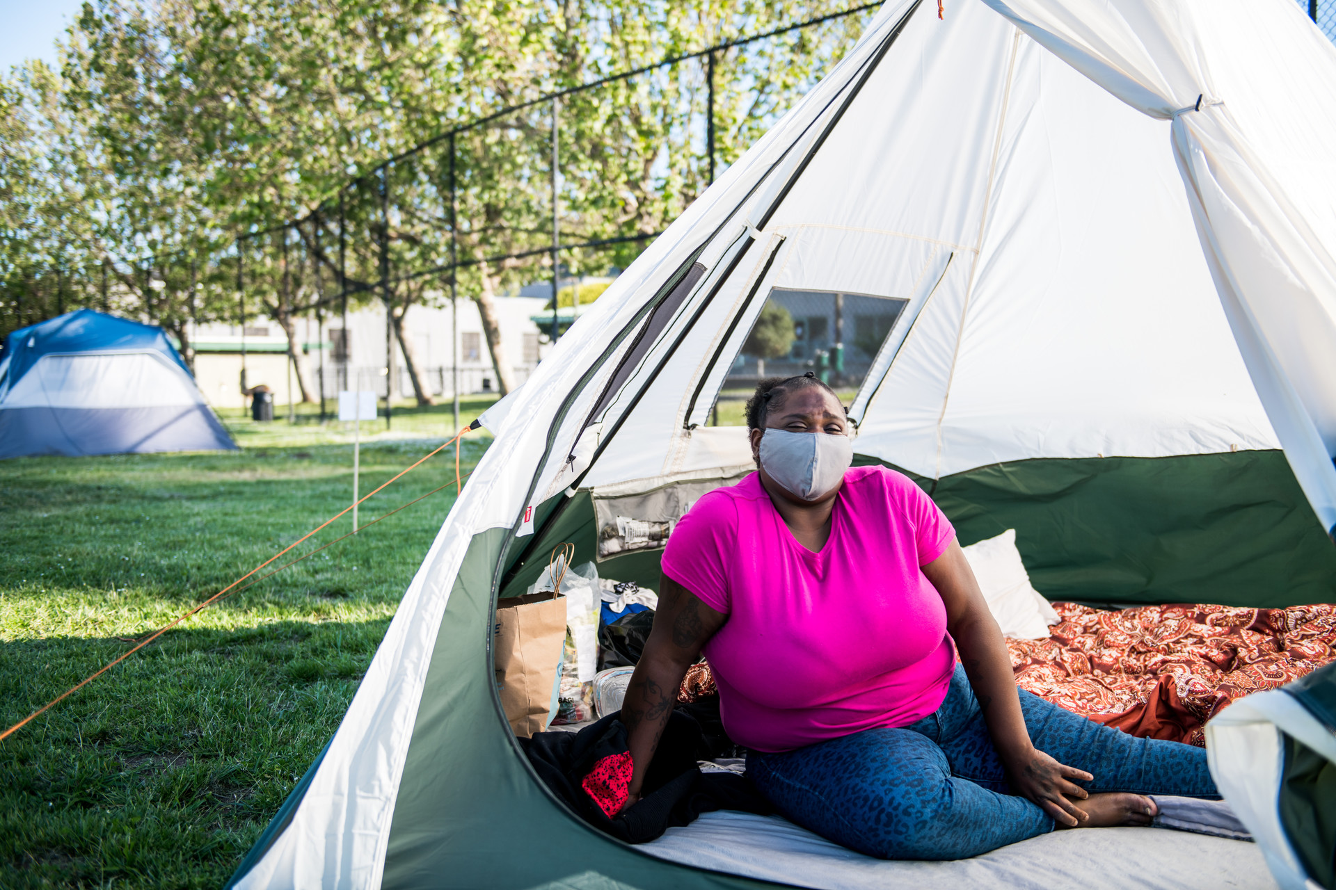 Tasha Swift sits inside her tent at the Bay View Park K.C. Jones Playground on May 5, 2020.