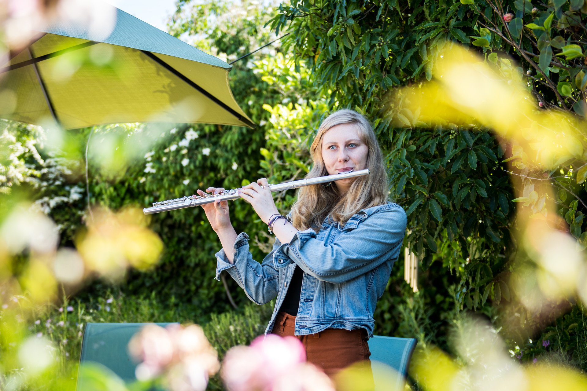Genevieve Schweitzer, a junior in high school, plays the flute in her backyard on April 6, 2020.
