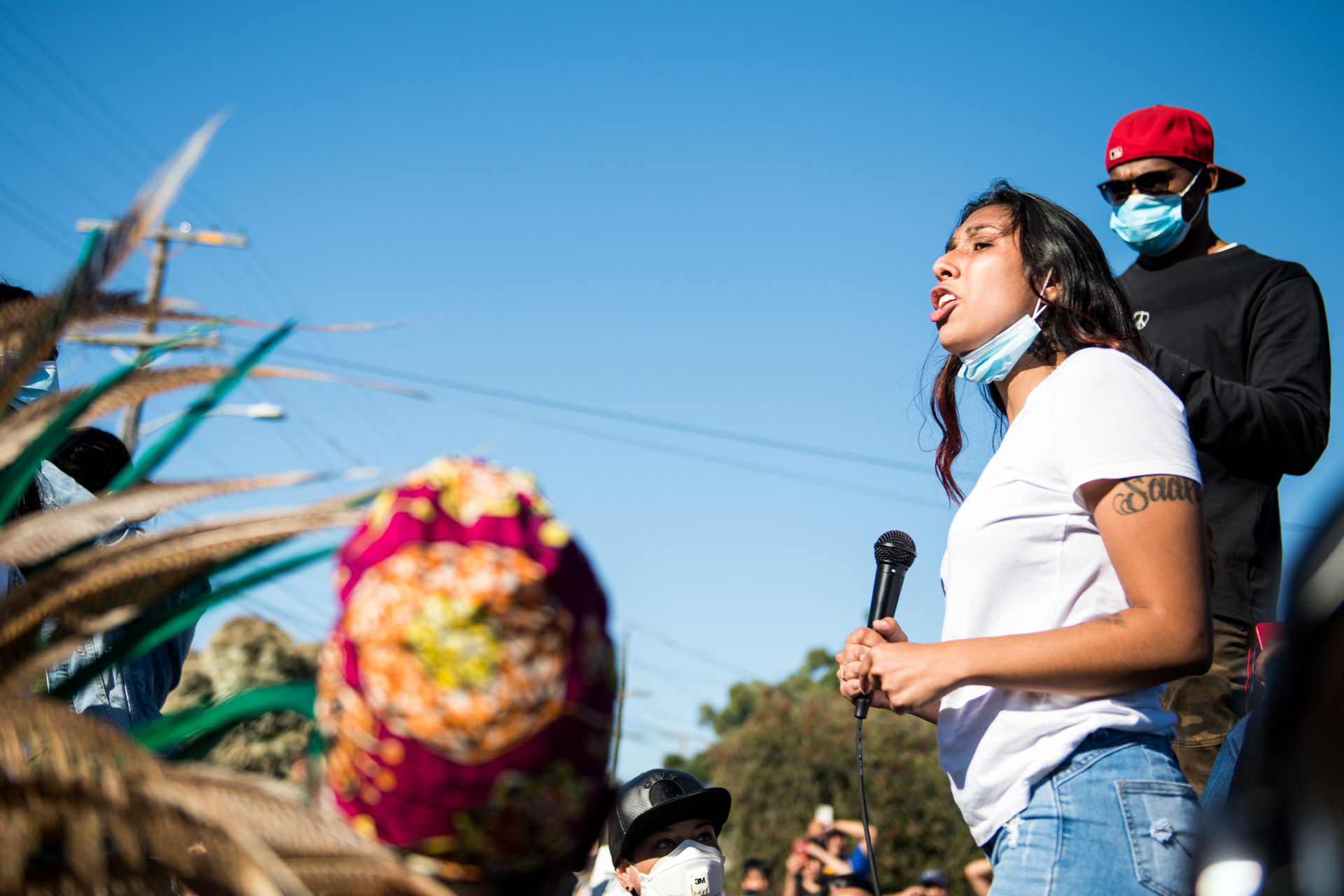 Erik Salgado's sister, Amanda Majail-Blanco, speaks during a march on June 8, 2020 in Oakland for her brother who was shot and killed by California Highway Patrol officers on June 6.