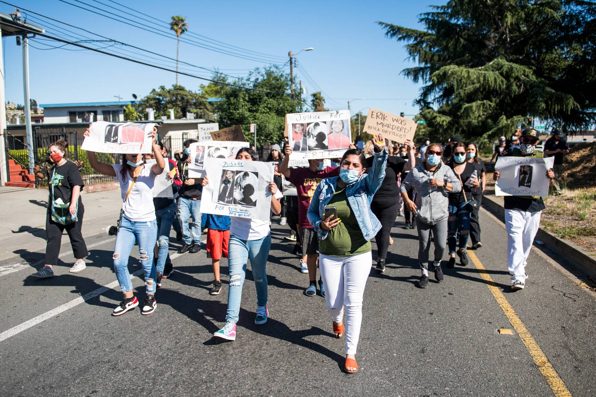 The family of Erik Salgado lead a large procession, marching from Elmhurst Middle School in East Oakland on Monday, June 8, to the site where Erik Salgado was shot and killed by California Highway Patrol officers this weekend. Beth LaBerge/KQED