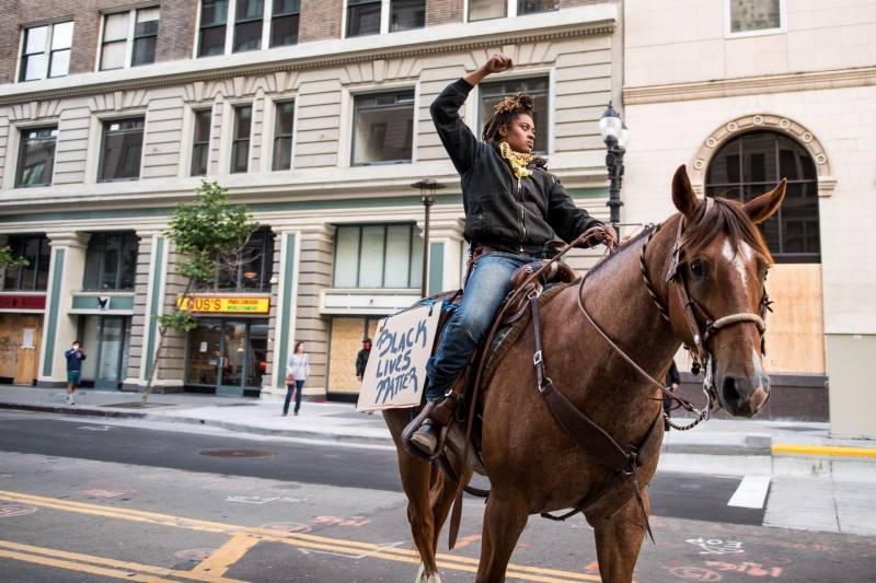 Brianna Noble and her horse Dapper Dan were among demonstrators marching on Broadway in Oakland on May 29, 2020, during a protest over the Minneapolis police killing of George Floyd.