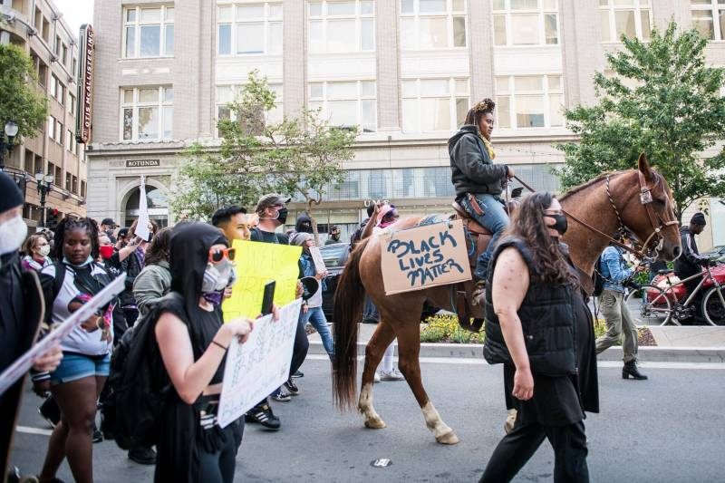 Brianna Noble rode among demonstrators marching on Broadway in Oakland on May 29, 2020, during a protest over the Minneapolis police killing of George Floyd.