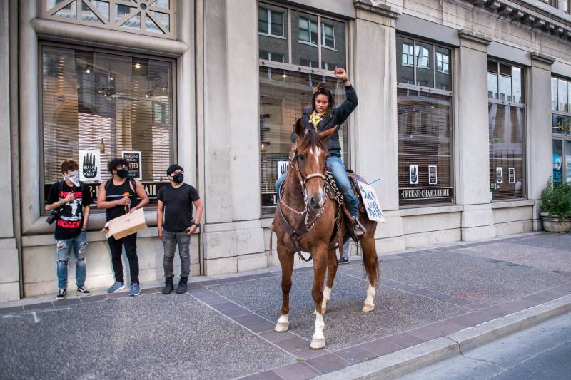 """Brianna Noble, owner of Mulatto Meadows ranch in Martinez, said she brought her horse Dapper Dan because she wanted to offer a """"good, bright, positive image to focus on, as opposed to some of the destruction,"""" during protests over the Minneapolis police killing of George Floyd."""
