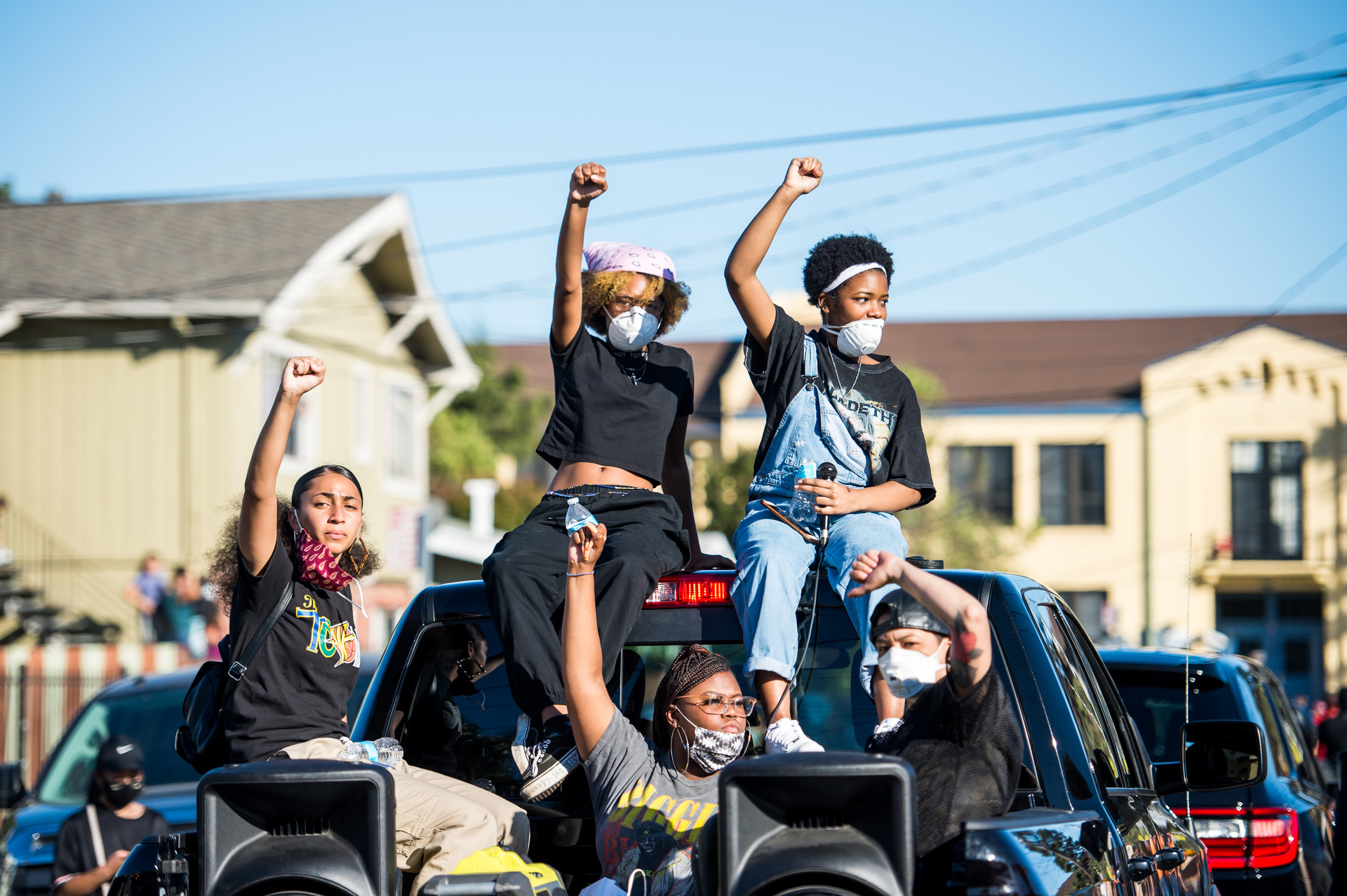 Isha Clarke (left) and other members of Oakland Black Youth Activists take part in a march for Erik Salgado, who was shot and killed by California Highway Patrol officers on June 6.