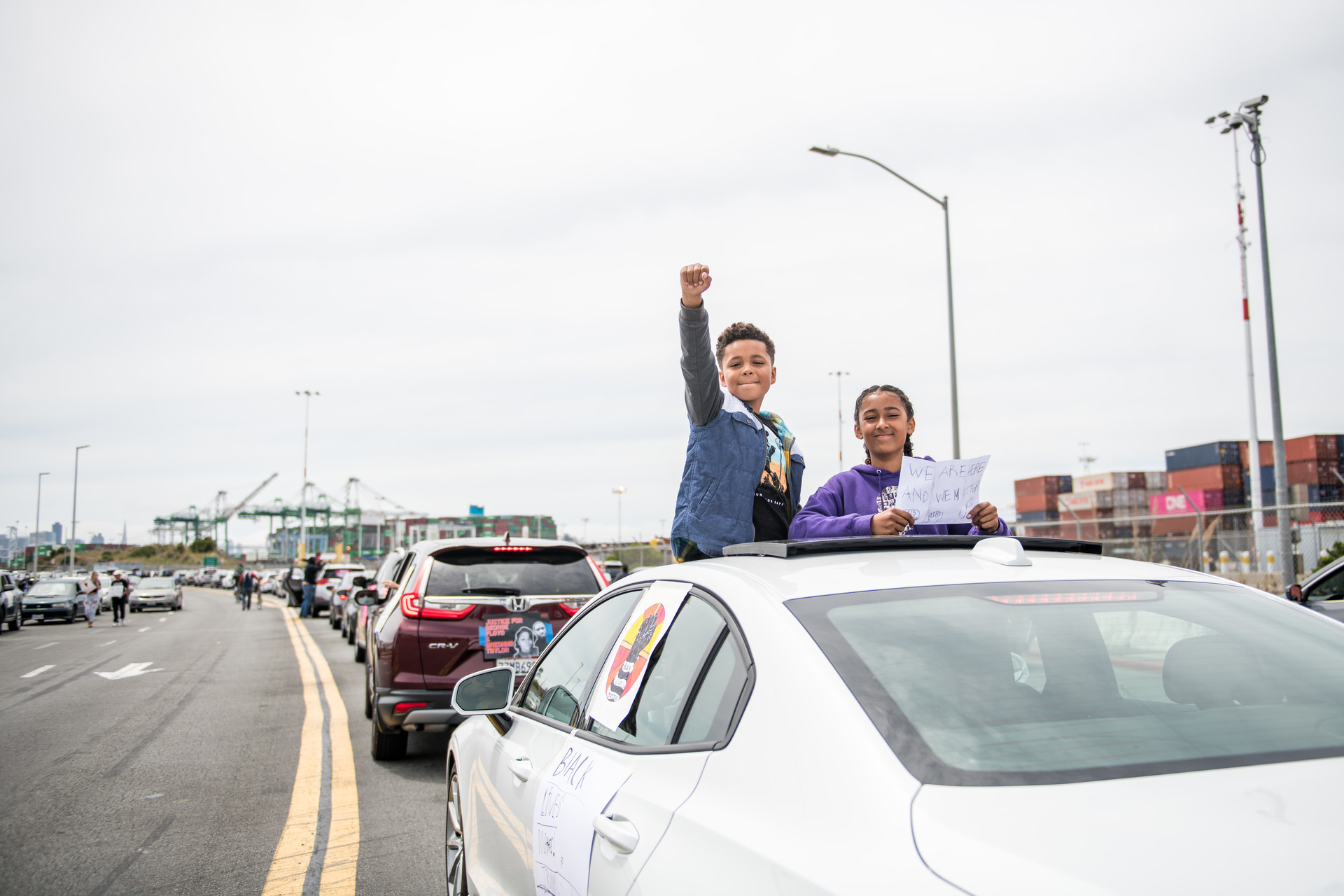Darius (left), Noema and their family joined the caravan of vehicles that lined up at the Port of Oakland before driving to Oakland and circling Lake Merritt on Sunday May 31, 2020 to protest the killing of George Floyd and other Black people at the hands of the police.