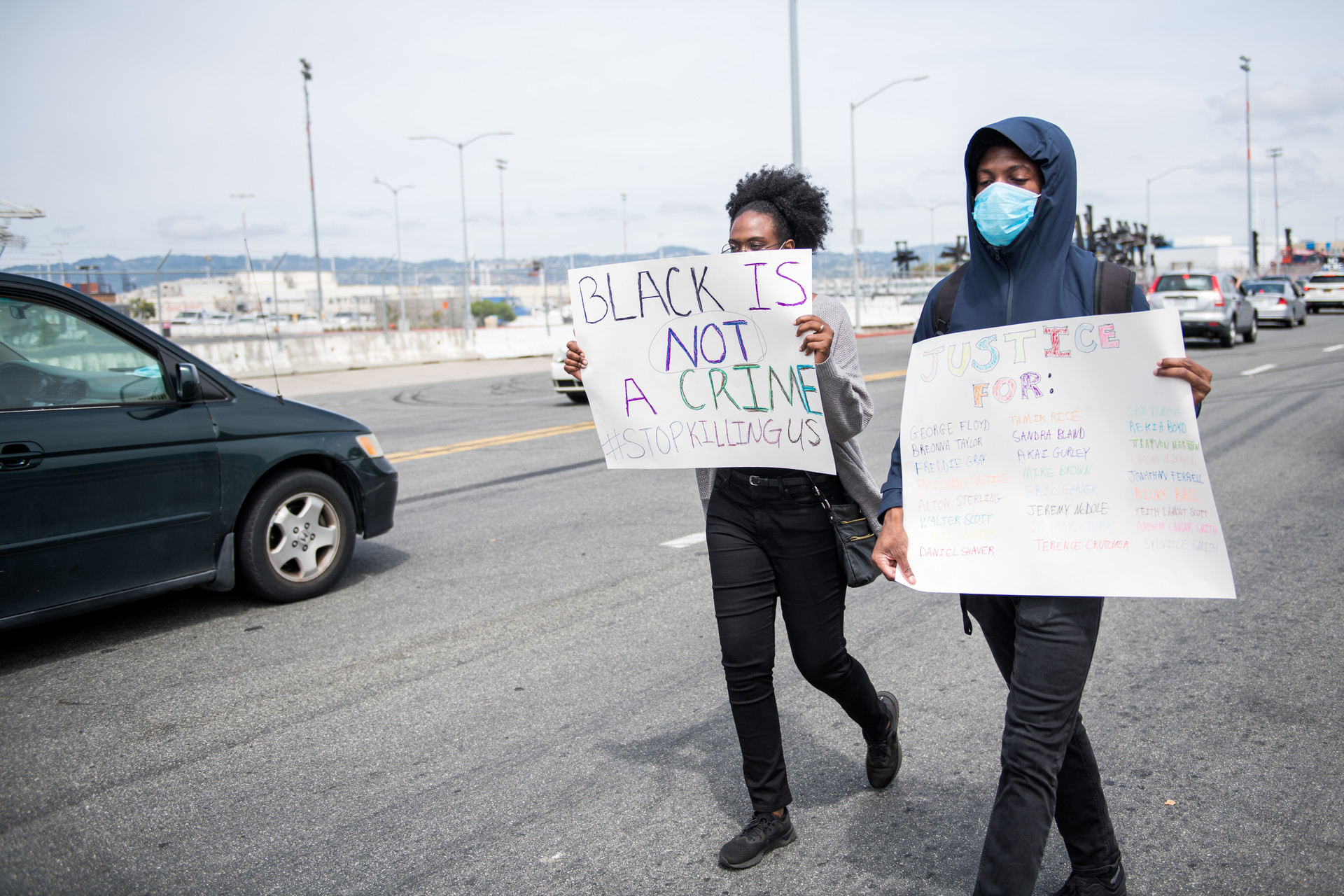 Demonstrators on foot joined thousands of vehicles lined up at the Port of Oakland before departing for Lake Merritt on Sunday.