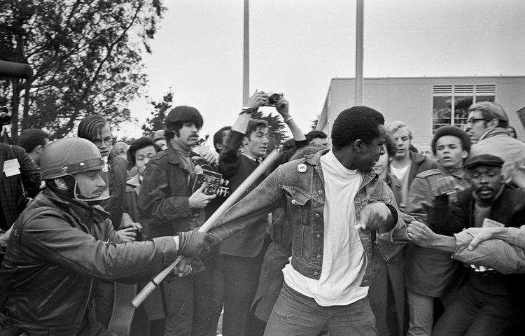 Police arrest Black Student Union member John Cleveland during the student strike at San Francisco State College 1968-1969, which resulted in the creation of a College of Ethnic Studies. Courtesy of San Francisco State University Photographic Timeline Project