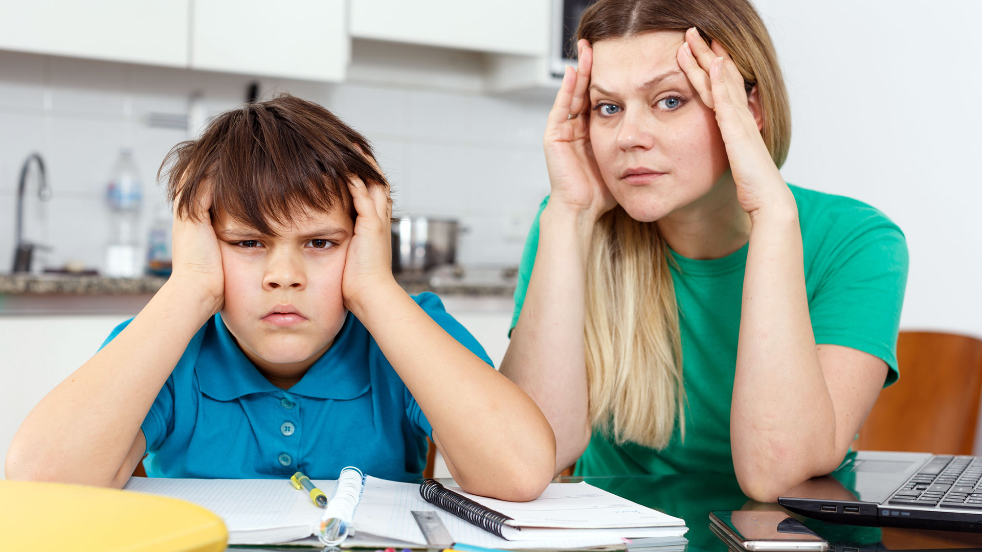 A mom and her son look fed up with learning at home.