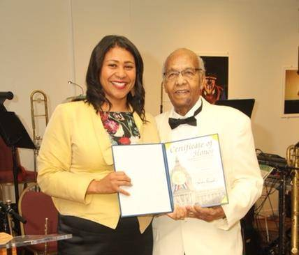 San Francisco Mayor London Breed presented Earl Gage Jr. with a Certificate of Honor during her tenure as District 5 supervisor.