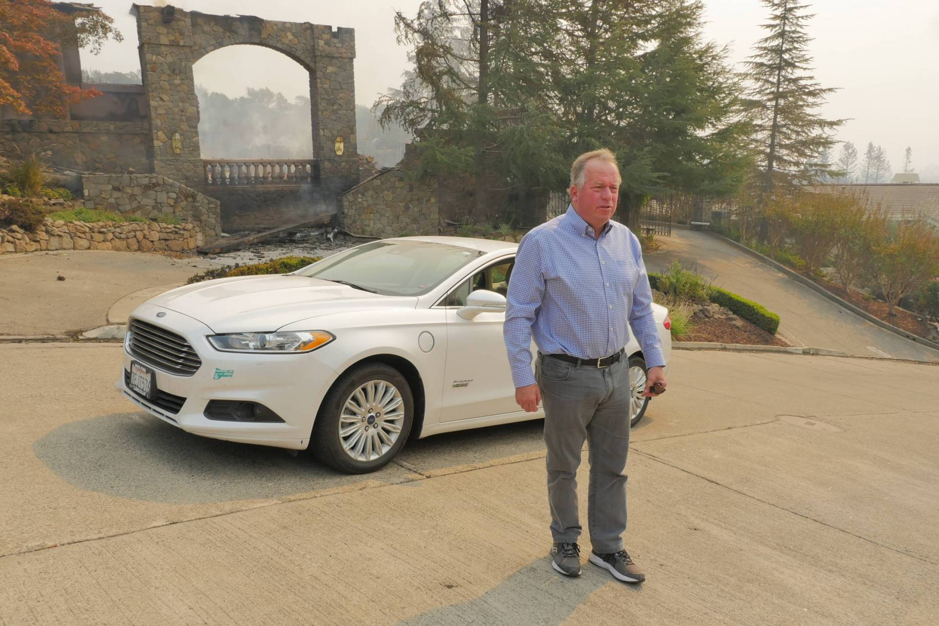 California State Sen. Bill Dodd stands outside a home at the Silverado Crest residential complex in Napa County not long after it was destroyed by the wine country firestorm of Oct. 2017. Dodd lived nearby.