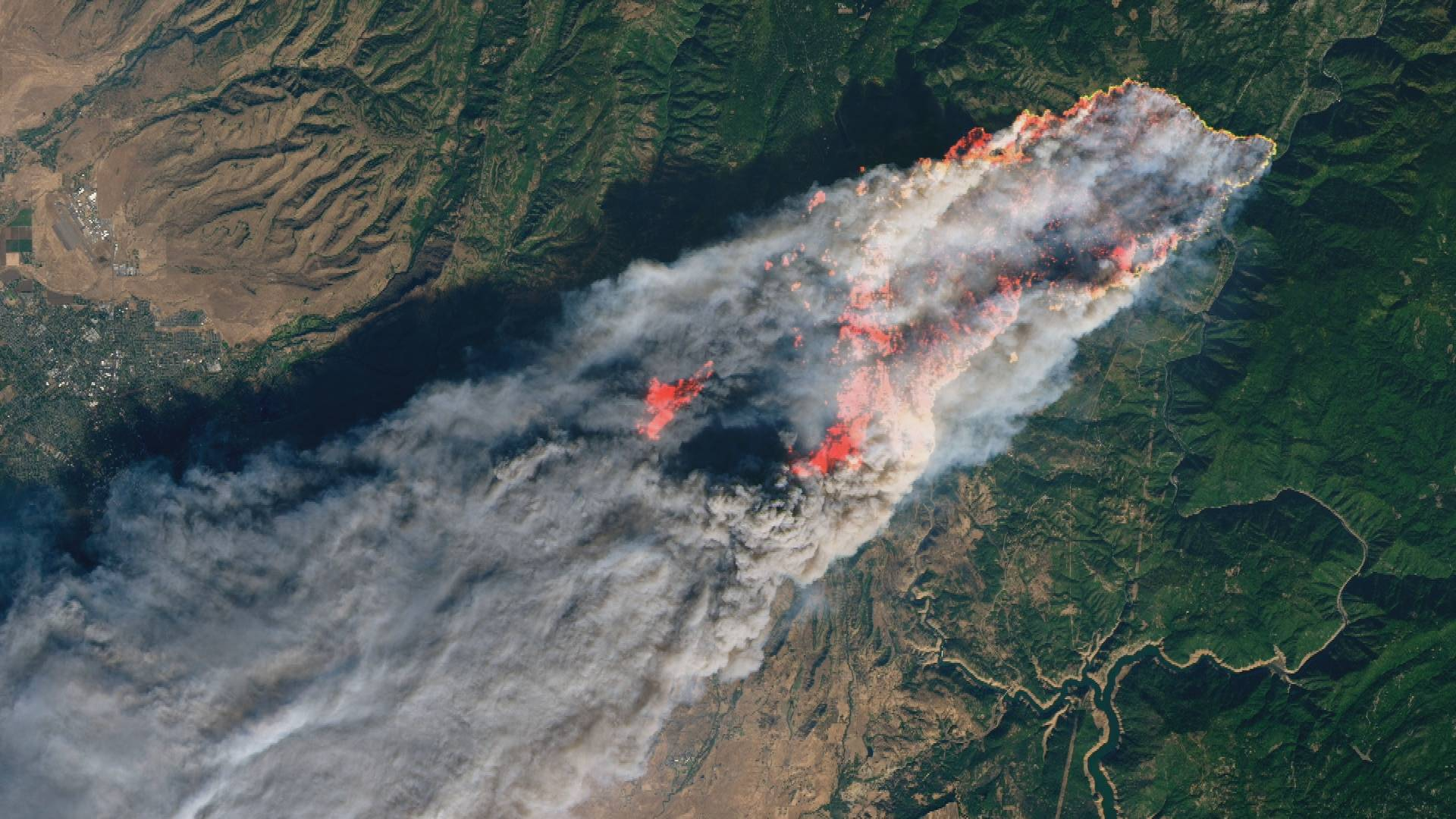 A satellite image shows the Camp Fire - driven by high winds after it was sparked by PG&E equipment - as it consumes the town of Paradise in Nov., 2018. The blaze remains the deadliest and most destructive in California history.