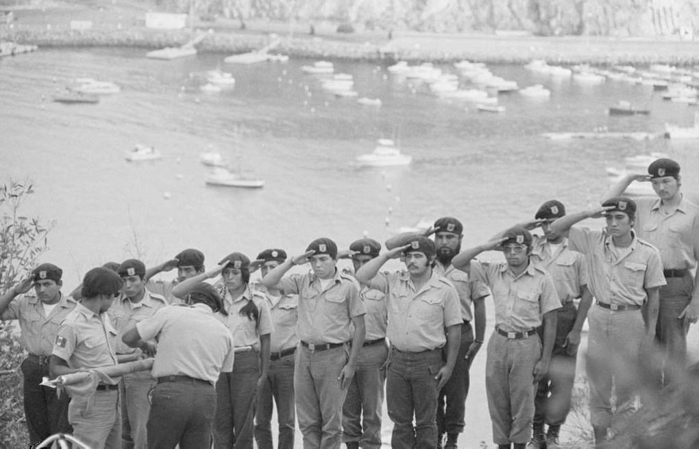 The Brown Berets salute at their camp on Catalina Island.  Maria Marquez Sanchez, La Raza photograph collection. Courtesy of UCLA Chicano Studies Research Center