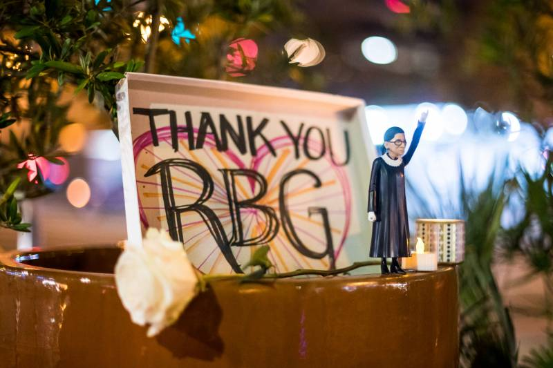 Betty Doerr brought her Ruth Bader Ginsburg figurine that she bought at Cliff's Variety to the candlelit vigil in Ginsburg's honor on Sep. 18, 2020.
