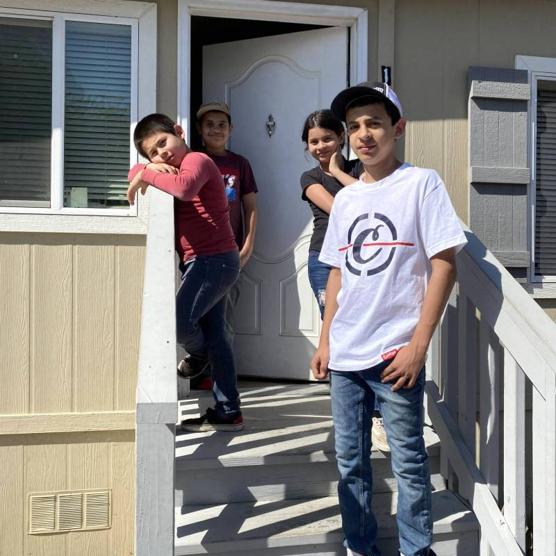 Adrian Avila and his younger siblings share one hot spot and two computers among them.