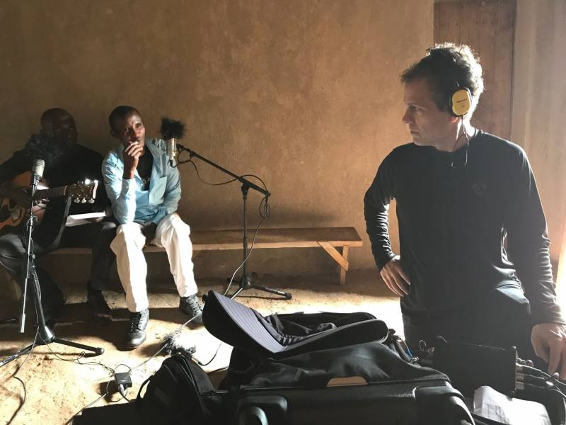 "Ian Brennan working with ""The Good Ones,"" a musical group in Rwanda."
