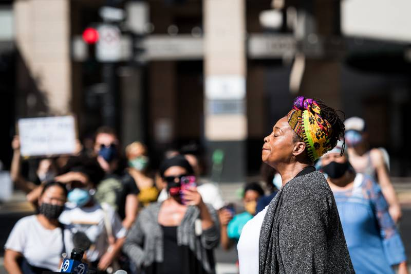 Ayodele Nzinga, director of Lower Bottom Playaz, speaks out against the killings of Breonna Taylor and other Black women by police, at a rally in Oakland on Sept. 24, 2020.