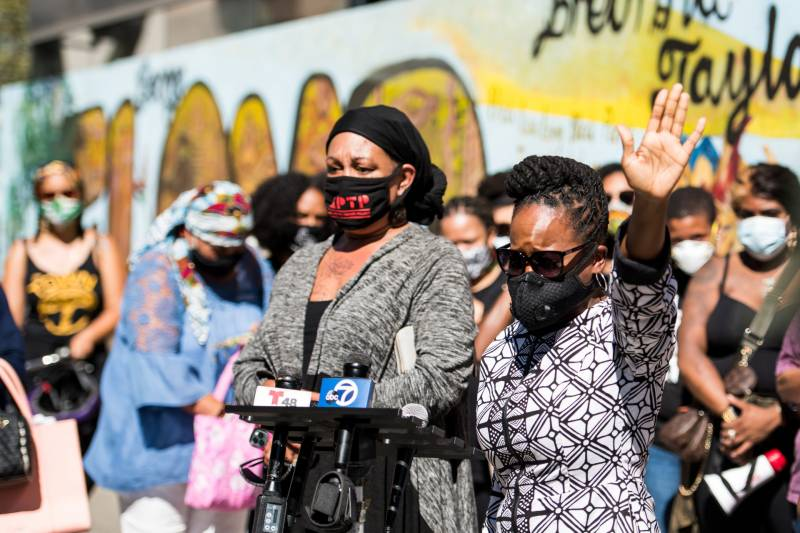 Cat Brooks (L) and Carroll Fife (R) speak at a Sept. 24, 2020, rally in Oakland to protest a Kentucky grand jury's decision not to charge any officers for the death of Breonna Taylor.