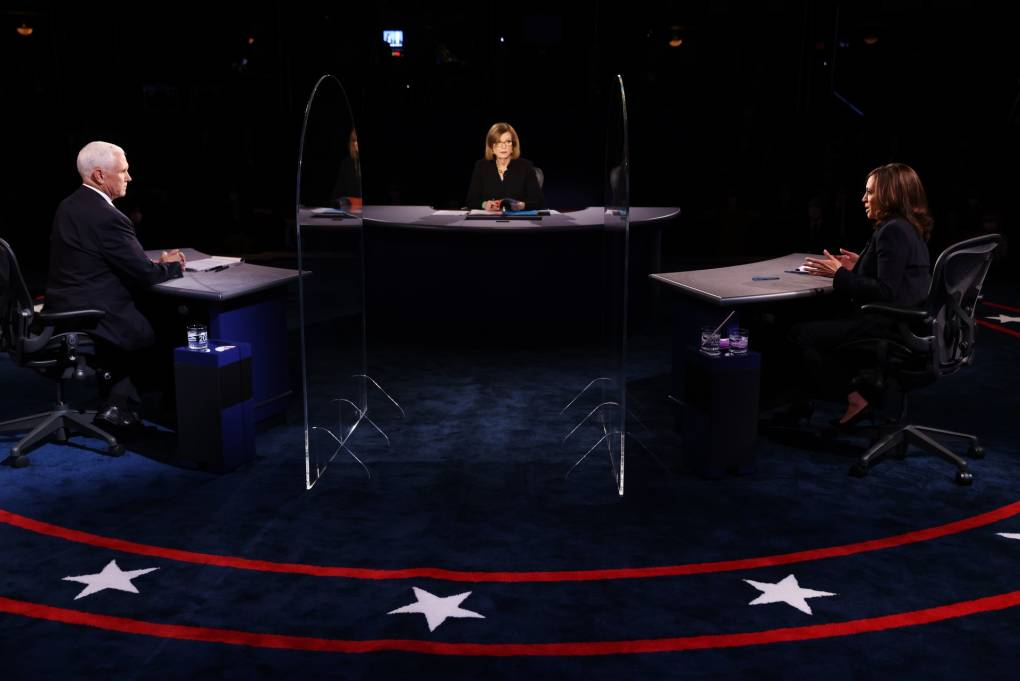 US Vice President Mike Pence (L), US Democratic vice presidential nominee and Senator from California, Kamala Harris (R), moderator Washington Bureau Chief for USA Today Susan Page (C), participate in the vice presidential debate in Kingsbury Hall of the University of Utah October 7, 2020 in Salt Lake City, Utah.  JUSTIN SULLIVAN/POOL/AFP via Getty Images