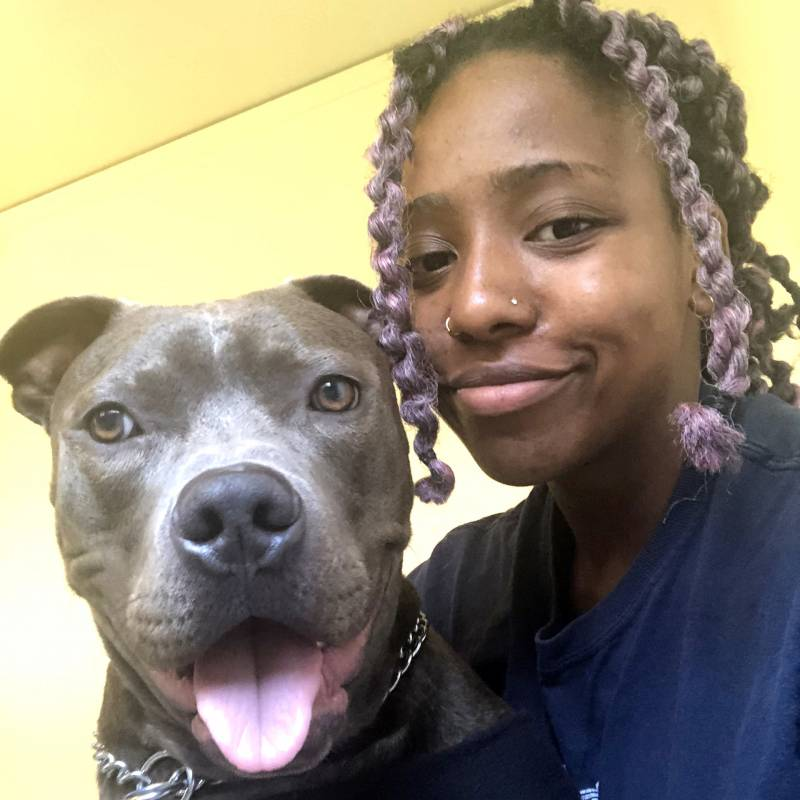 """Jada Ross with her dog Blue. """"He's just very attention seeking. And I need that sometimes,"""" Ross said."""