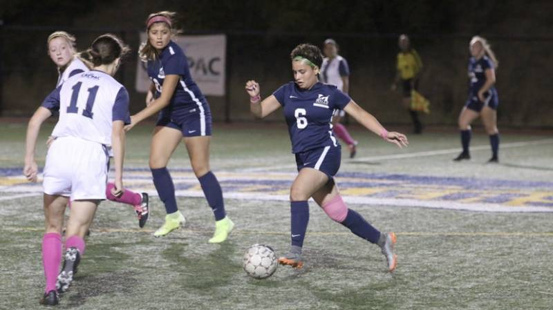 Before the pandemic, Alondra Rios (center, with ball) played soccer for Mills College. While she can no longer do that in person, she wakes up most mornings to work out with her teammates virtually.