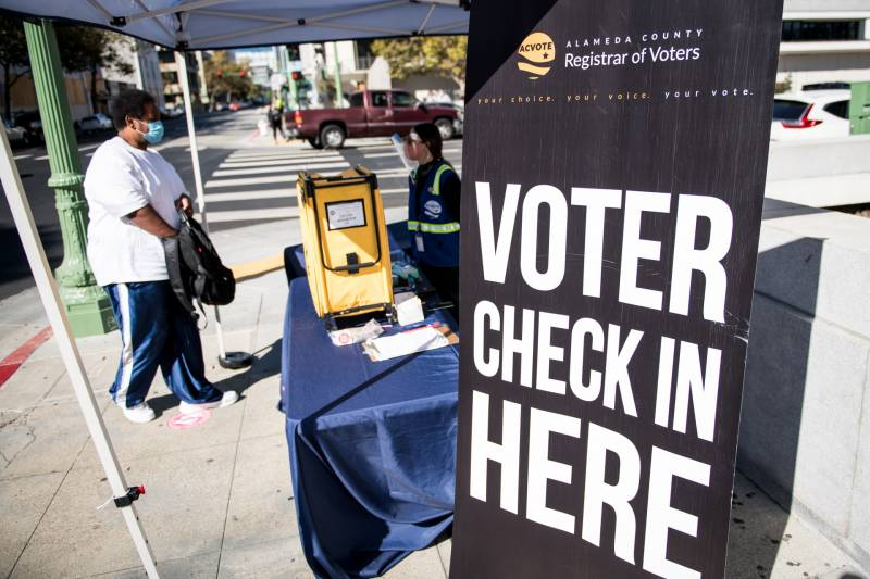 A voter approaches an Alameda County Registrar of Voters ballot drop box in Oakland on Oct. 27, 2020.