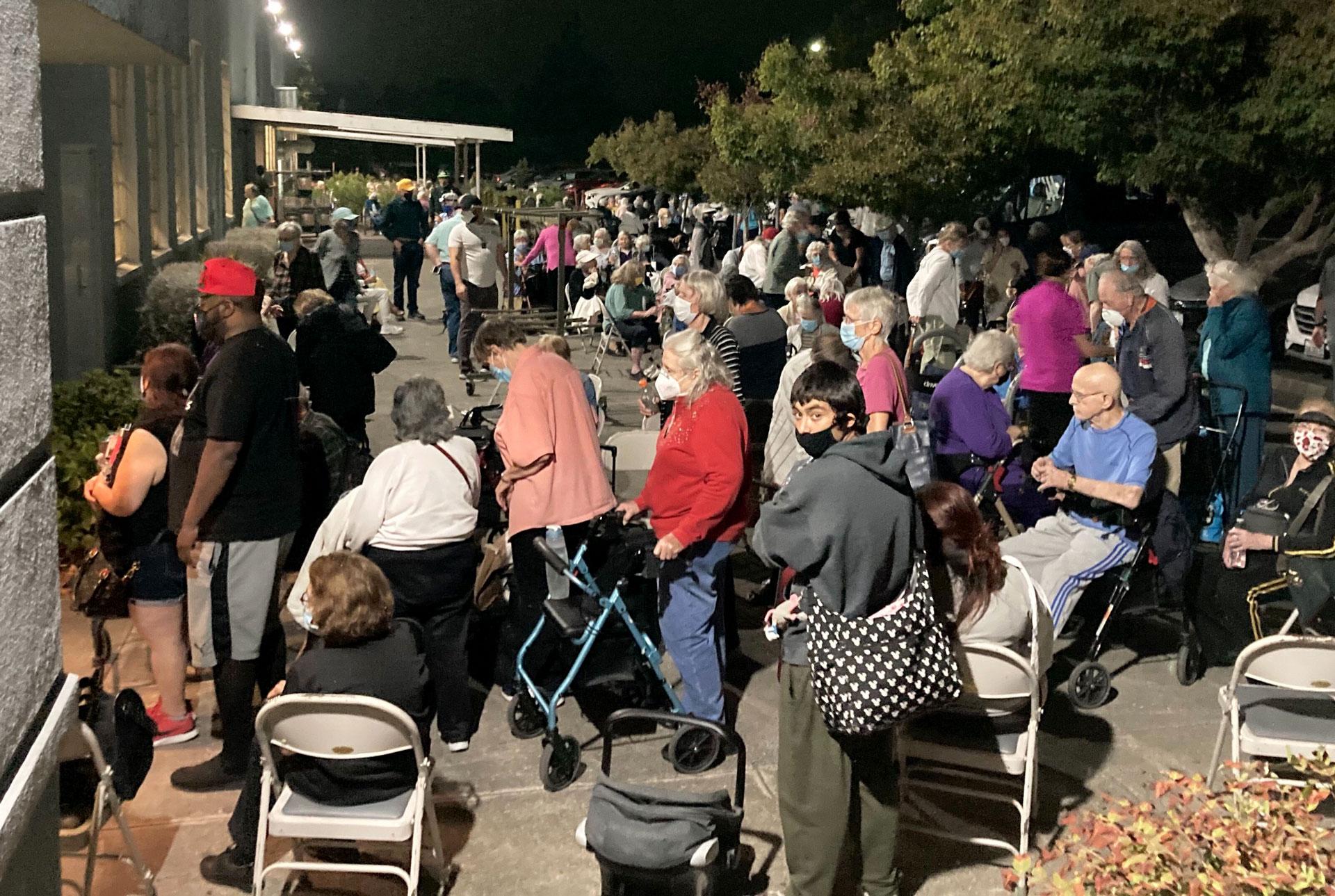 senior evacuees wait outside