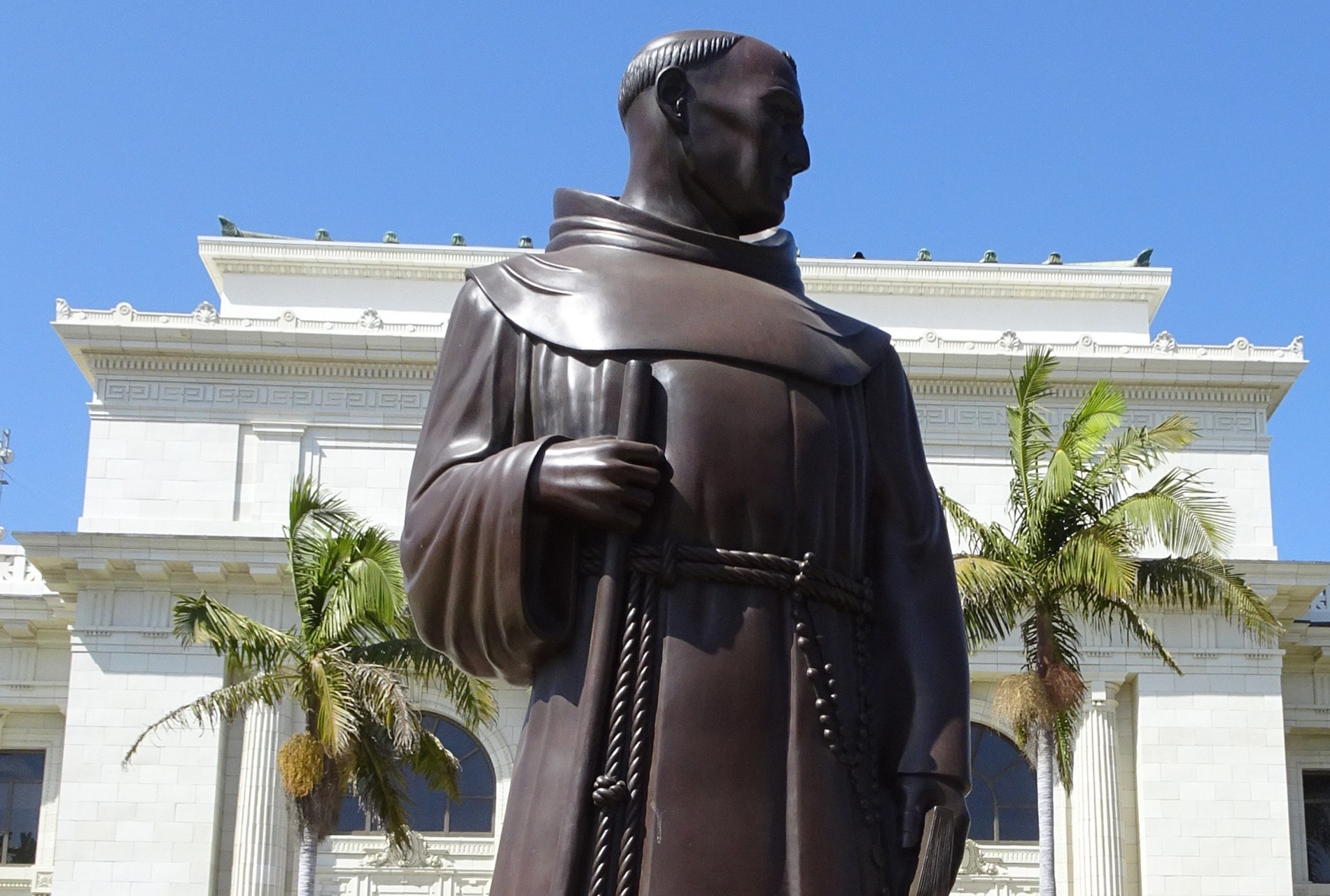 A bronze figure of the 18th century missionary Junípero Serra stands outside Ventura City Hall, sculpted in 1936 by Uno John Palo Kangas. Indigenous activists say a reckoning with Serra's legacy is long overdue.