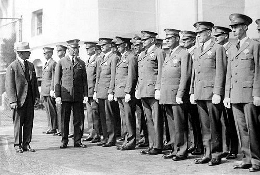 "August Vollmer inspects a line of police officers standing at attention. Courtesy of <a href=""https://www.cityofberkeley.info/Police/Home/Historical_Unit.aspx"">Berkeley Police Department Historical Unit</a>"