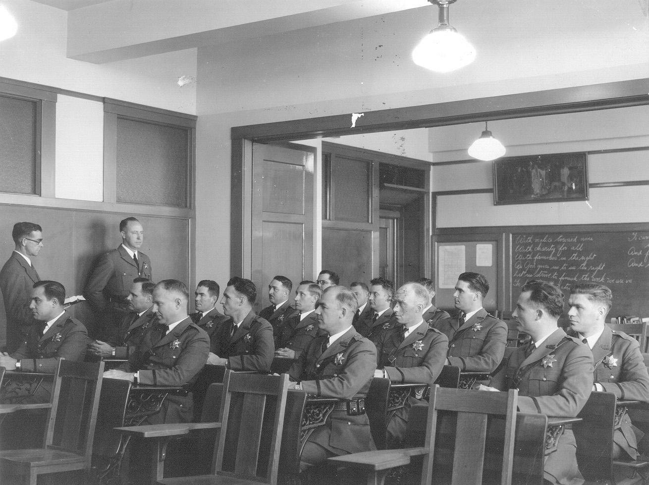 August Vollmer pioneered regular training for his officers. Here police officers listen to a lecture held at Berkeley City Hall in 1935.