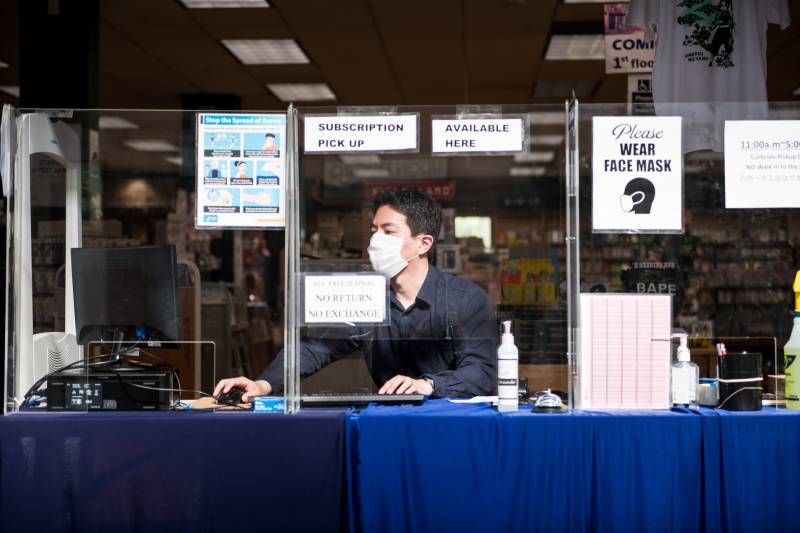 Naoya Morishita, the store manager, works at the Kinokuniya Book Store in the Japan Center West Mall on Sep. 2, 2020.