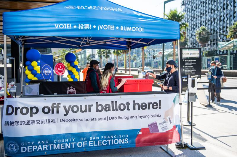 Voters drop off their mail-in ballots at the Chase Center official ballot drop-off location on Oct. 31, 2020.