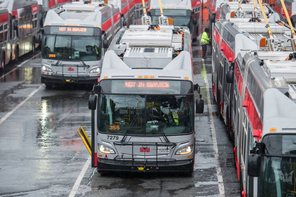San Francisco Muni buses sit at a bus yard on Bryant and Mariposa streets in April 2020. Beth LaBerge/KQED